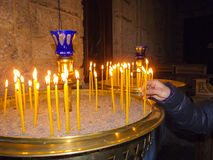 Burning Candles inside Stoned Chapel Stock Images