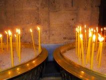 Burning Candles inside Stoned Chapel Royalty Free Stock Photo