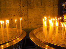 Burning Candles inside Stoned Chapel Stock Photography