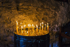 Burning Candles inside Stoned Monastery Royalty Free Stock Photography