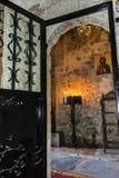 Burning Candles inside Stoned Monastery Royalty Free Stock Photos