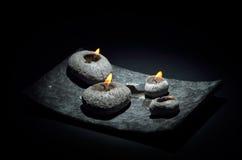 Burning candles isolated on black Royalty Free Stock Photo