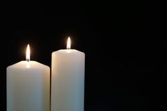 Burning candles isolated on black background. Burning candles isolated on a black background Royalty Free Stock Images