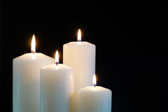 Burning candles isolated on black background. Burning candles isolated on a black background Stock Images