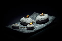 Burning candles isolated on black background Stock Image