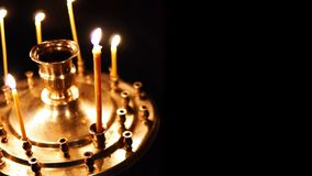 Burning candles isolated gold in the altar on a dark background in the Christian Orthodox Church stock video