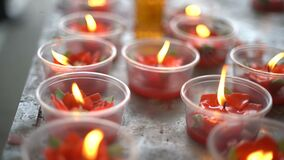 Burning candles light to worship. Buddha stock footage