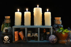 Burning candles with magic objects Royalty Free Stock Photo