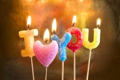 Burning candles making I love you. Valentine burning candles making words I love you stock photo