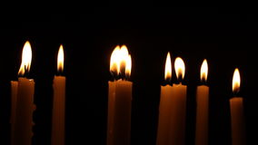 Burning candles melt in the Darkness stock video footage