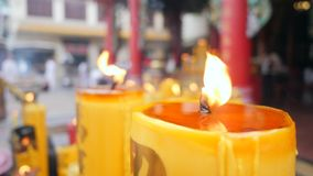 Burning Candles near Buddhist Temple. Thai Religion Background Concept. 4K Flame in Slow Motion. stock footage