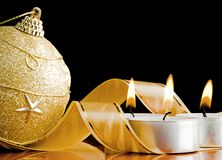 The burning candles and New Year's toy Stock Images