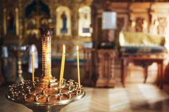 Burning candles in the Orthodox Church royalty free stock photography