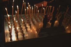 Burning candles in the Orthodox Church. Ministry in the Church Royalty Free Stock Photos