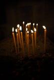 Burning candles over black background Stock Photography