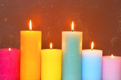 Burning Candles In Pastel Colors royalty free stock photography
