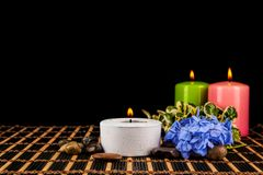 Burning candles and pebbles for aromatherapy session Royalty Free Stock Photography