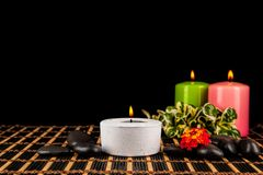 Burning candles and pebbles for aromatherapy session Stock Image