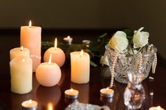 Burning candles and perfume Stock Photos