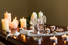 Burning candles and perfume Stock Image