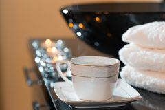 Burning candles and pile of towels Stock Photo