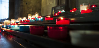 Burning candles. For promise payment in catholic church Royalty Free Stock Photo