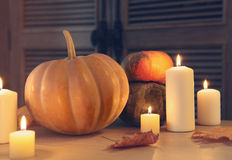 Burning candles and pumpkins Royalty Free Stock Photos