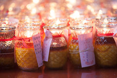 Burning candles in Quan Yin temple Stock Photo