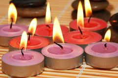 Burning candles ready for the. Aromatherapy session Royalty Free Stock Images