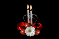 Burning candles with red bow and Easter eggs. Greeting card with burning candles white flower and Easter eggs Stock Photography