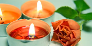 Burning candles and red rose Royalty Free Stock Image
