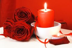 Burning Candles and Red Roses. Burning Candles and Bouquet of Red Roses Royalty Free Stock Images
