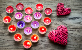 Burning candles with retro cane hearts Royalty Free Stock Image