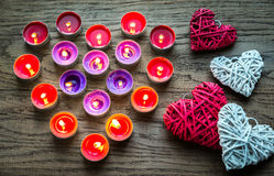 Burning candles with retro cane hearts Royalty Free Stock Images