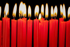 Burning candles in a row Royalty Free Stock Photo