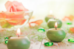 Burning candles salt spa Stock Images