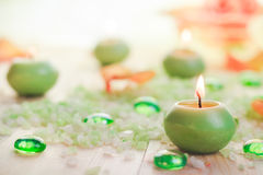 Burning candles salt spa Stock Photography