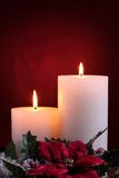 Burning candles with seasonal decorations Stock Photo