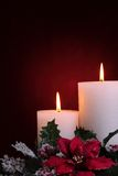Burning candles with seasonal decorations Stock Photos