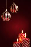Burning candles with seasonal decorations Royalty Free Stock Image