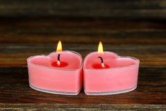 Burning candles in the shape of a heart Royalty Free Stock Photography