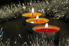 Burning candles and silver decor Stock Photos