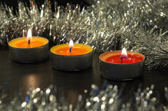 Burning candles and silver sparkling decor Stock Photography