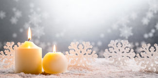 Burning candles on snow Stock Photo