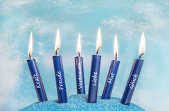 Burning candles - spa or relaxation concept in blue. Royalty Free Stock Photos