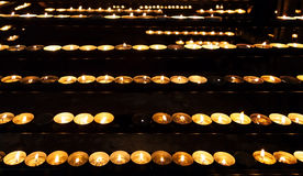 Burning candles in the St. Stephan cathedral Stock Photos