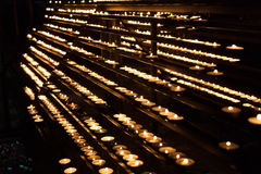 Burning candles in the St. Stephan cathedral Stock Images