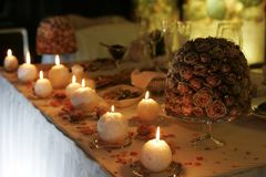 Burning Candles on a table Royalty Free Stock Photography