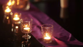 Burning candles on table Royalty Free Stock Images