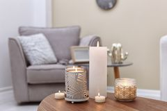 Burning candles on table indoors. Interior decor element royalty free stock photos
